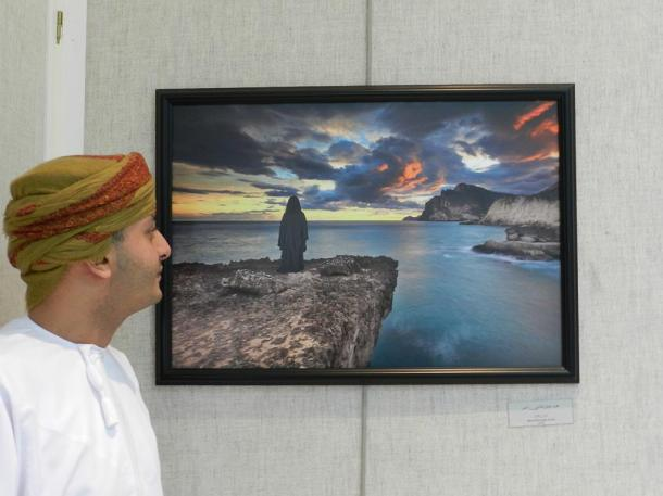 The sunset and the movements of the clouds inspired Mohammed Awadh Alhadi (AFIAP) for this picture.  With the landscape and the picture of the woman (his daughter) he made a composition. The photo of his daughter was studio work.