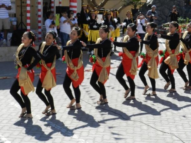 Sinulog dance: moving two steps forward, one step backward