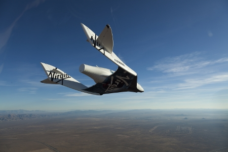 SpaceShipTwo, christened VSS Enterprise during a glide flight in Mojave, CA, USA. Photo by Mark Greenberg