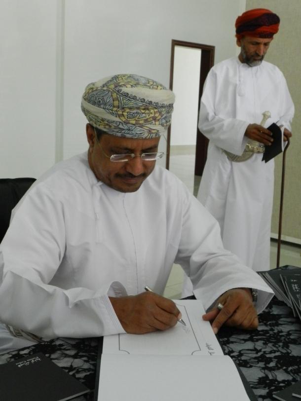Signing of the book by Sh. Ahmed bin Abdullah bin Said Al Rawas, Director General Affairs Minister's Office-Salalah Diwan of Royal Court