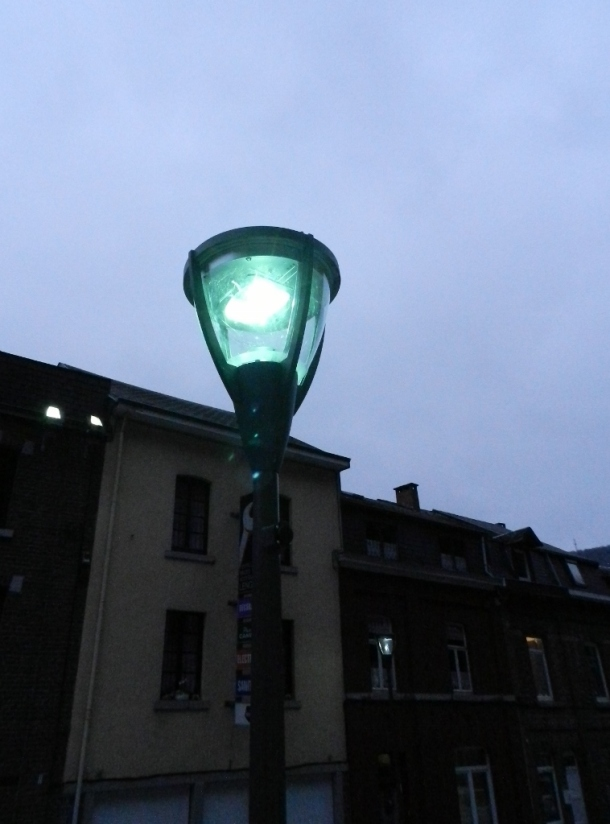 In 'La Roche' in my hometown in Belgium, the street lights are programmed. They go on and off around the time of the sunrise and the sunset.